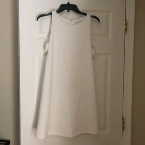 White cutout dress. Perfect for bridal shower!
